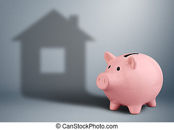 Piggy bank with shadow as house,housing industry finance...