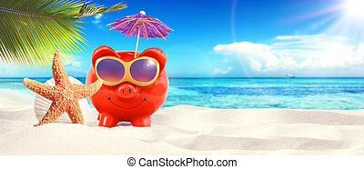 piggy bank with sunglasses on tropical beach - summer holiday.