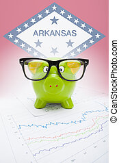 Piggy bank with US state flag on background - Arkansas