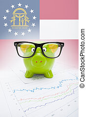 Piggy bank with US state flag on background - Georgia