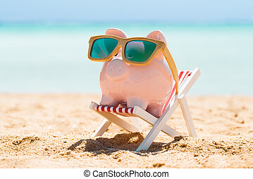 Piggy Bank With Wooden Sunglasses On The Deck Chair