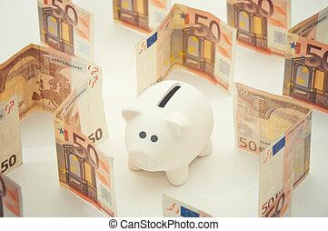 Piggy money bank in labyrinth