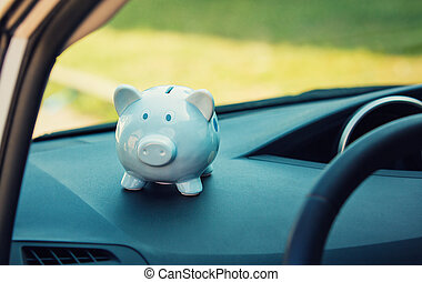 Piggy money box inside a car transportation. Saving money for vehicle purchase. Dealership offering credits.