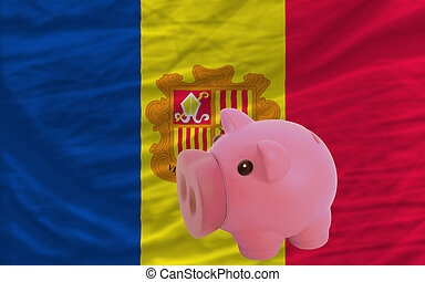 piggy rich bank and national flag of andorra
