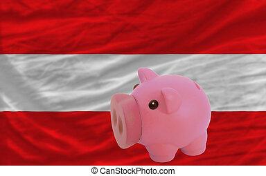 piggy rich bank and national flag of austria