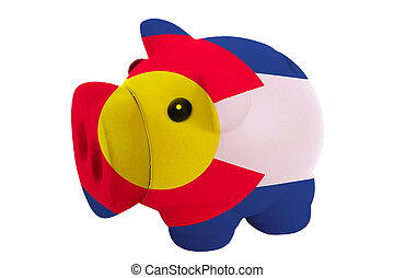 piggy rich bank in colors flag of us state of colorado for savings on white background