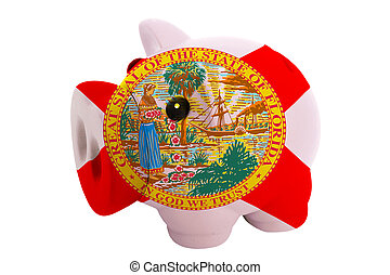 piggy rich bank in colors flag of us state of florida for savings on white background