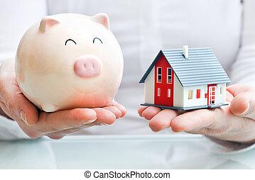 piggy, segurando, banco casa, modelo, mãos