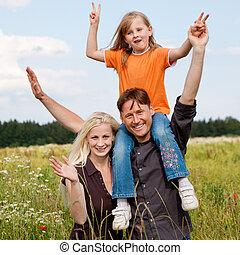 Piggyback family outdoors