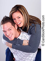 Piggyback Ride - Attractive Young Couple Playing Around...