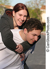 Piggyback ride - Two happy teenagers