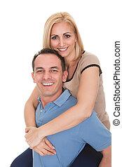piggybacking, mulher, homem jovem