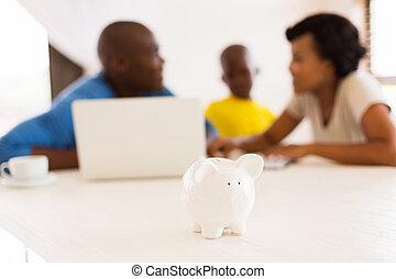 piggybank close up - african family doing some financial...