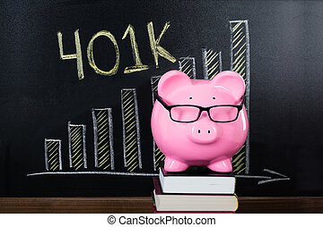 Piggybank In Front Of Blackboard