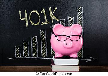 Piggybank In Front Of Blackboard