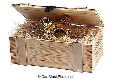 piggybank in wooden box with wood-wool