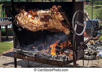 Piglet roasted on a spit
