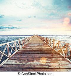 pijler, ondergaande zon , zee