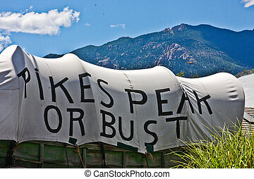Pikes Peak or Bust - covered wagon in Colorado Springs with...