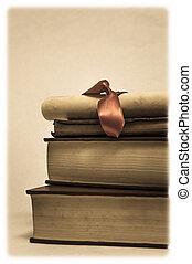 pila de libros, y, diploma, rúbrica