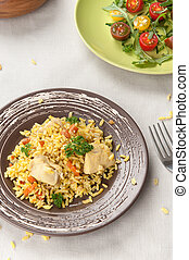 pilaf with chicken and vegetable salad close up
