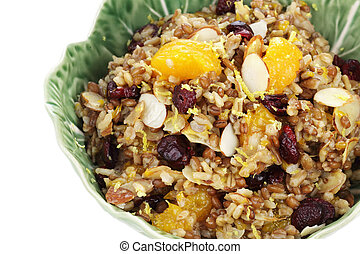 Pilaf with whole grains, nuts, and dried fruit for a delicious side dish or breakfast. Clipping path included.