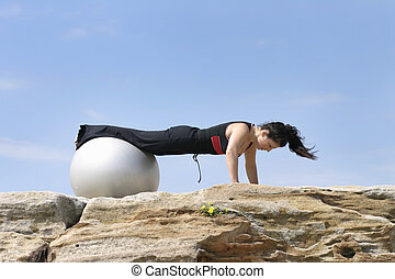 Pilate Push ups - Woman performs a pilate exercise
