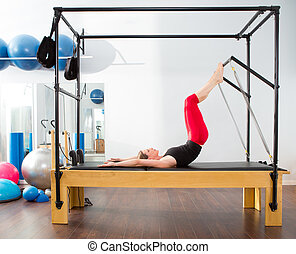 Pilates aerobic instructor woman in cadillac fitness...