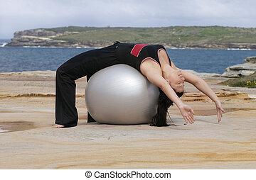 Pilates - ball stretch backwards
