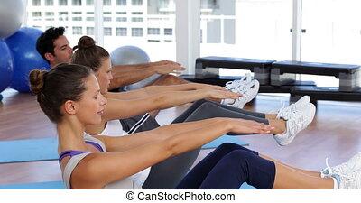 Pilates class balancing on exercise