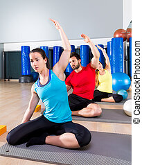 Pilates exercise the mermaid stretching obliques