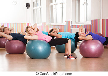 Pilates exercise with fitness balls