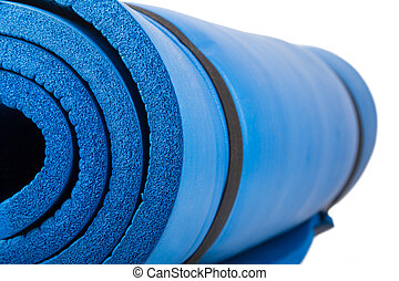 Pilates Mat - Blue pilates mat, isolated on white...