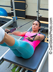 Pilates reformer workout exercises woman brunette at gym ...