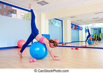 Pilates woman fitball arabesque exercise workout