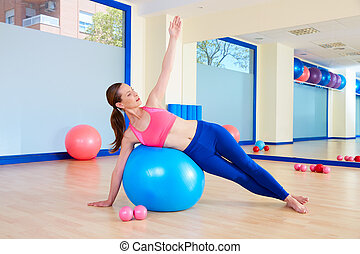 Pilates woman fitball side bend exercise workout