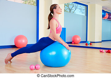 Pilates woman fitball swan exercise workout