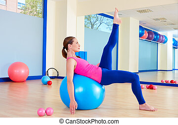 Pilates woman fitball swiss ball exercise workout at gym...