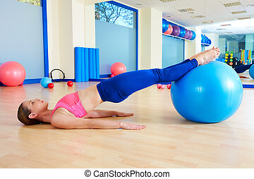Pilates woman pelvic lift fitball exercise workout at gym...