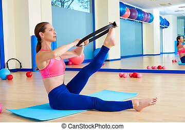 Pilates woman scissor magic ring exercise workout at gym...