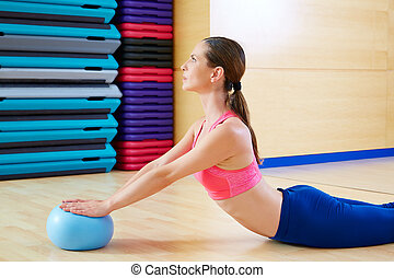 Pilates woman stability ball swan exercise workout