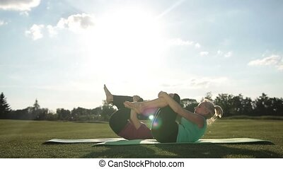 Pilates women doing rolling like a ball exercise