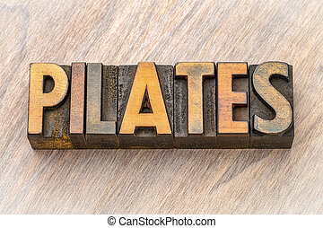 pilates - word abstract in wood type