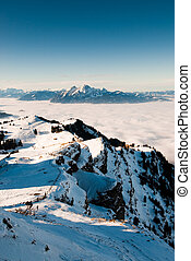 View of the Pilatus mountain range above the clouds, taken from Rigi, Switzerland.