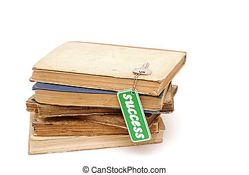 pile book with a key to success