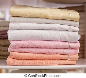 Pile colored of terry towels on the shelf