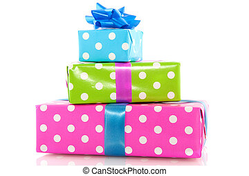 Pile colorful dotted presents with ribbons and bow