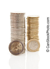 Pile of 1 and 2 Euro money coins over white background