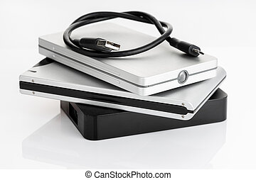 Pile of a group of external Hard disk drive on white table