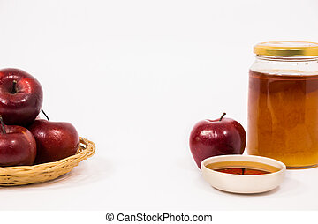 Pile of apples and red apple and jar of honey bowl of honey...